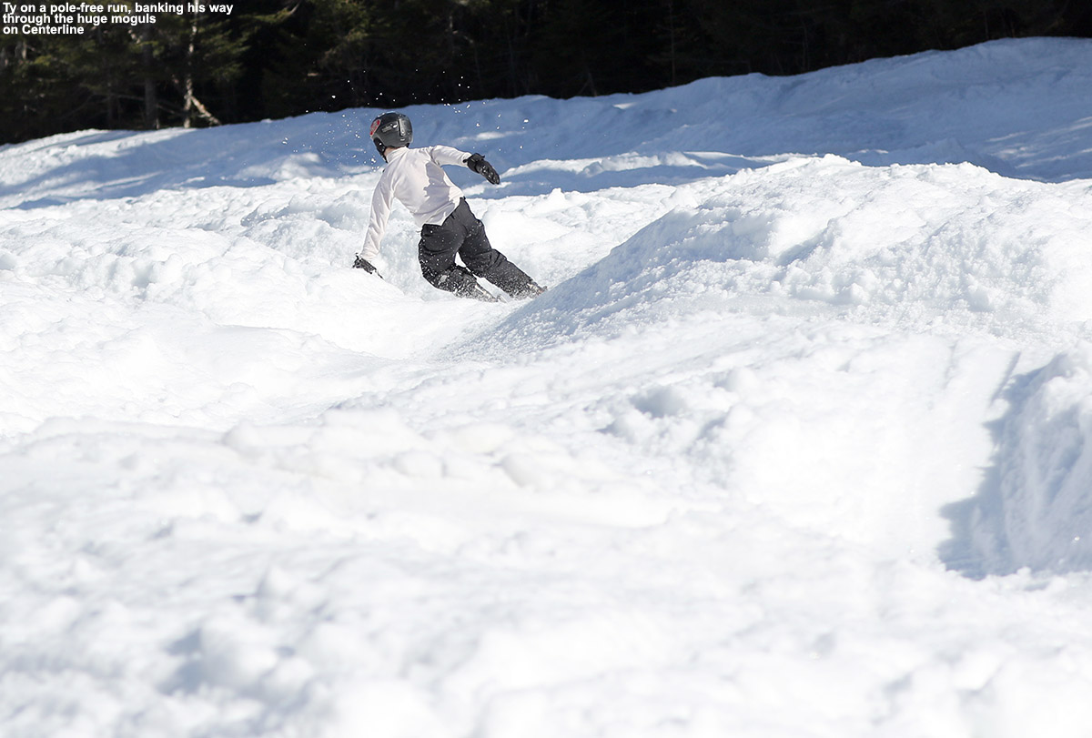 An image of Ty skiing among large moguls in the spring on the Centerline trail at Stowe Mountain Resort in Vermont