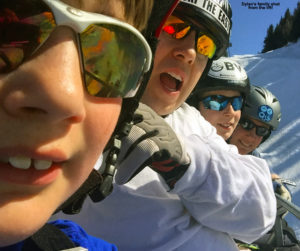 An image of the Silveira family on the Fourrunner Quad at Stowe Mountain Resort in Vermont