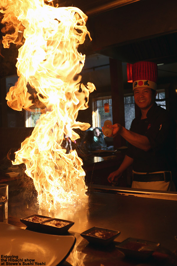 An image showing a huge flame on the hibachi grill at Sushi Yoshi restaurant in Stowe, Vermont
