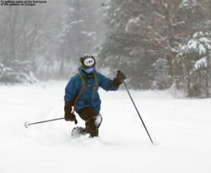 An image of Ty Telemark skiing in powder on the Cougar trail at Bolton Valley Resort in Vermont