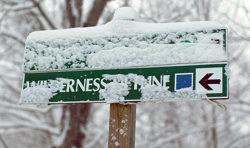An image of trails signs with snow at Bolton Valley Ski Resort in Vermont
