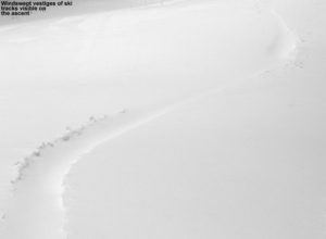 An image of a ski track in powder snow partially filled in by the wind at Bolton Valley Ski Resort in Vermont