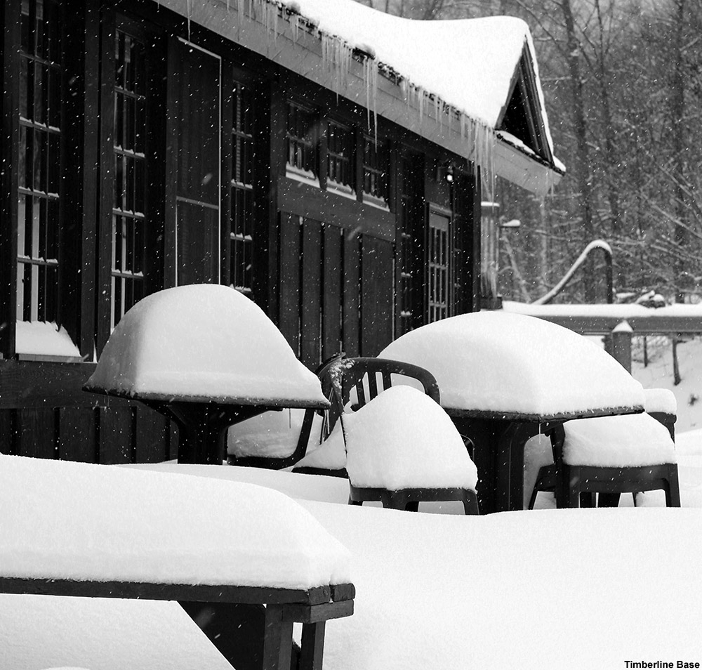 An image of snow accumulations outside the Timberline Base Lodge at Bolton Valley Ski Resort in Vermont