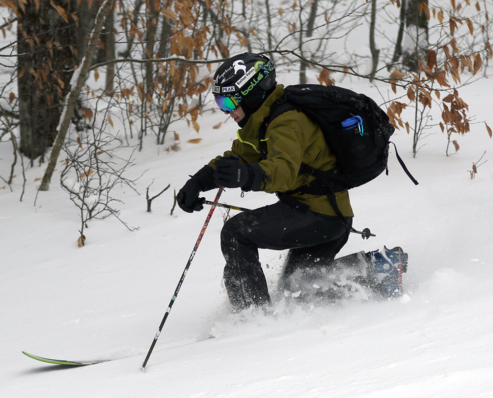 An image of Jay Telemark skiing at Bolton Valley Ski Resort in Vermont