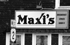 An image of the sign for Maxi's restaurant in Waterbury, VT