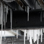 An image of icicles below the deck of the Cliff House at Stowe Mountain Resort in Vermont