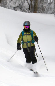 An image of Erica skiing in powder at Bolton Valley Resort in Vermont