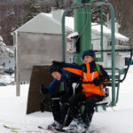 An image of Ty and Dylan on a chairlift at Bolton Valley Ski Resort in Vermont