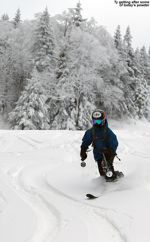 An image of Ty Telemark skiing in powder at Bolton Valley Resort in Vermont