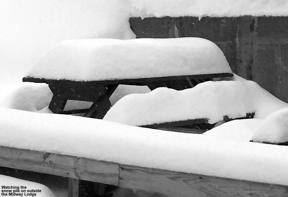 An image of snow outside the Midway Base Lodge at Stowe Mountain Ski Resort in Vermont