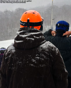 An image of snow building up on a skier during a snowstorm at Stowe Mountain Resort in Vermont