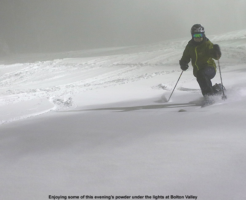 An image of Jay skiing powder at night under the lights at Bolton Valley Resort in Vermont