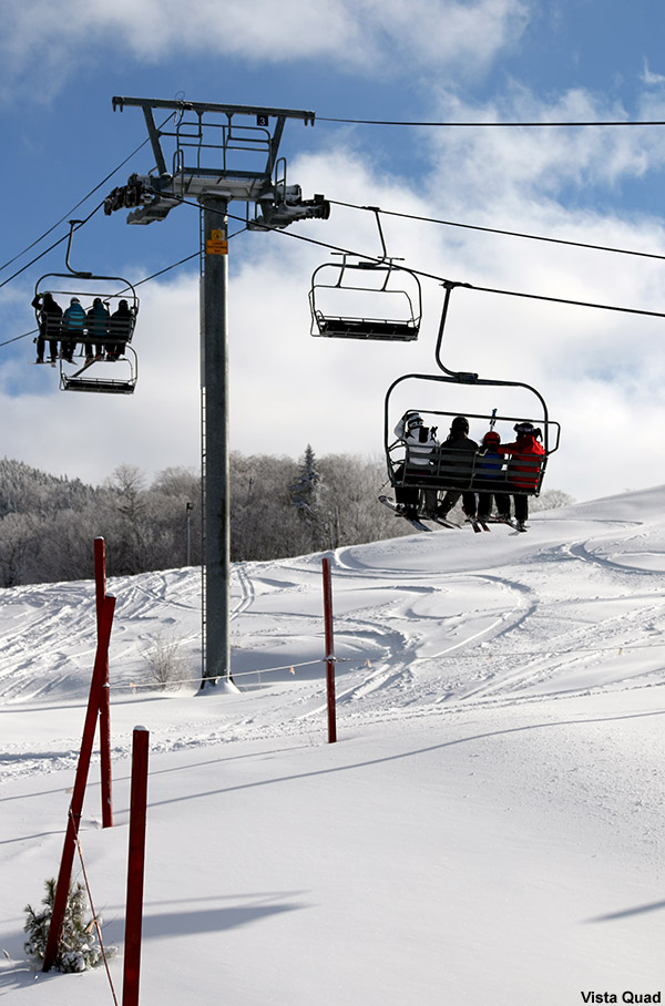 An image of the Vista Quad chairlift at Bolton Valley Ski Resort in Vermont