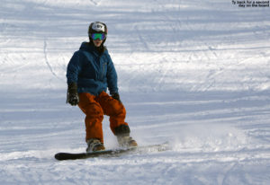 An image of Ty snowboarding at Bolton Valley Ski Resort in Vermont