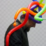 An image of a man making balloon art at Bolton Valley Ski Resort in Vermont