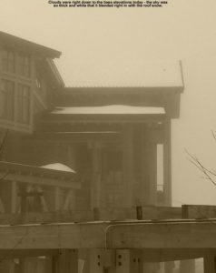 An image of low clouds in the Spruce Peak Village at Stowe Mountain Ski Resort in Vermont