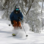 An image of Ty skiing powder in the Wilderness Woods at Bolton Valley Resort in Vermont