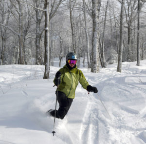 An image of Erica skiing some powder snow in the Wilderness Woods area of Bolton Valley Resort in Vermont