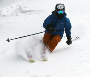 An image of Ty skiing powder on the Tattle Tail trail at Bolton Valley Resort in Vermont