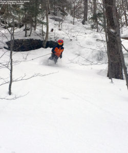 An image of Dylan skiing some powder along the boundary of Spruce Peak at Stowe Mountain Resort in Vermont
