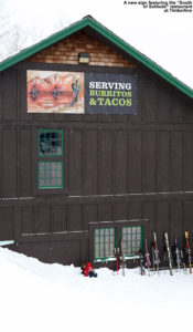 "An image showing the ""South of Solitude"" sign on the Timberline Base Lodge at Bolton Valley Ski Resort in Vermont"