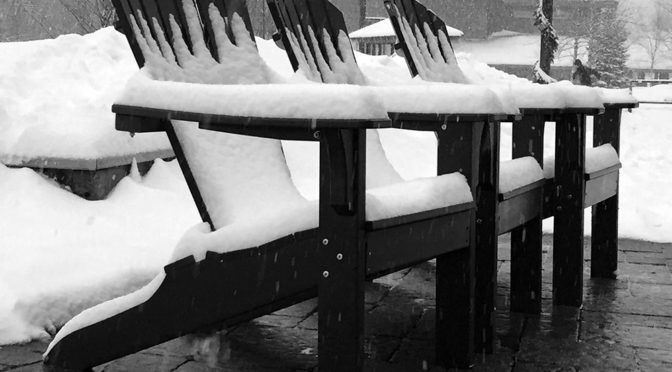 An image of deck chairs with a bit of snow accumulation from Winter Storm Orson at Stowe Mountain Ski Resort in Vermont