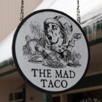 "An image of the sign for ""The Mad Taco"" restaurant in Waitsfield, Vermont"