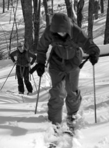An image of Ty skinning while Erica looks on in the Lincoln Gap area of Vermont