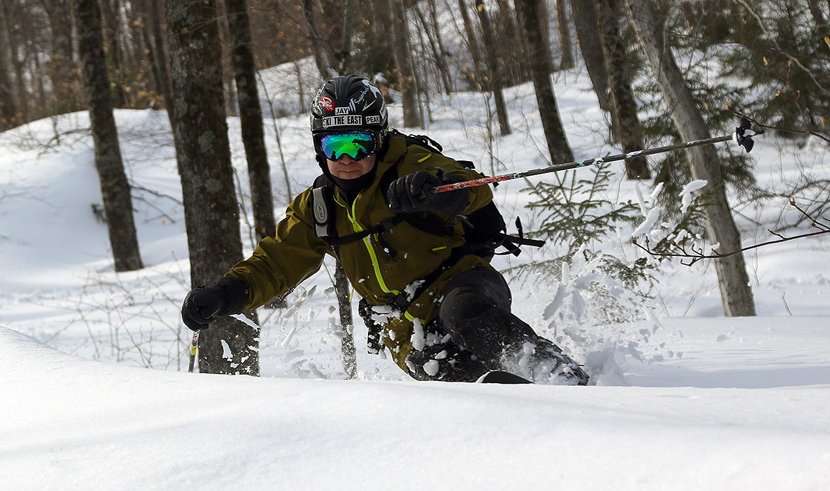 An image of Jay Telemark skiing in powder in the Lincoln Gap area of Vermont