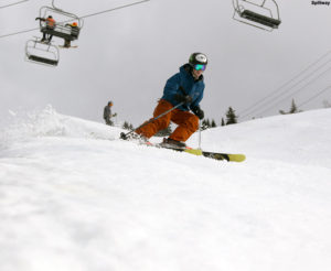 An image of Ty skiing in spring snow on the Spillway trail at Bolton Valley Ski Resort in Vermont