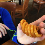 An image of a curly french fry from the Great Room Grill at Stowe Mountain Resort in Vermont