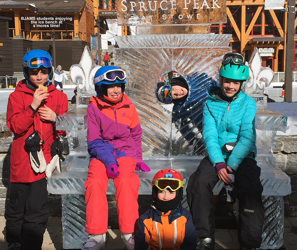 An image of some BJAMS students on the ice bench in the Spruce Peak Village at Stowe Mountain Resort in Vermont