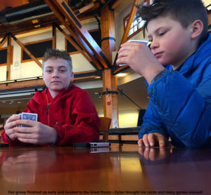 An image of some BJAMS students playing cards in the Great Room at Stowe Mountain Resort in Vermont