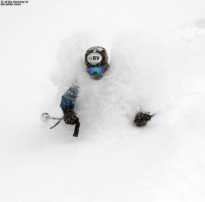 An image of Ty skiing in deep powder up and around his shoulders and head at Stowe Mountain Resort in Vermont