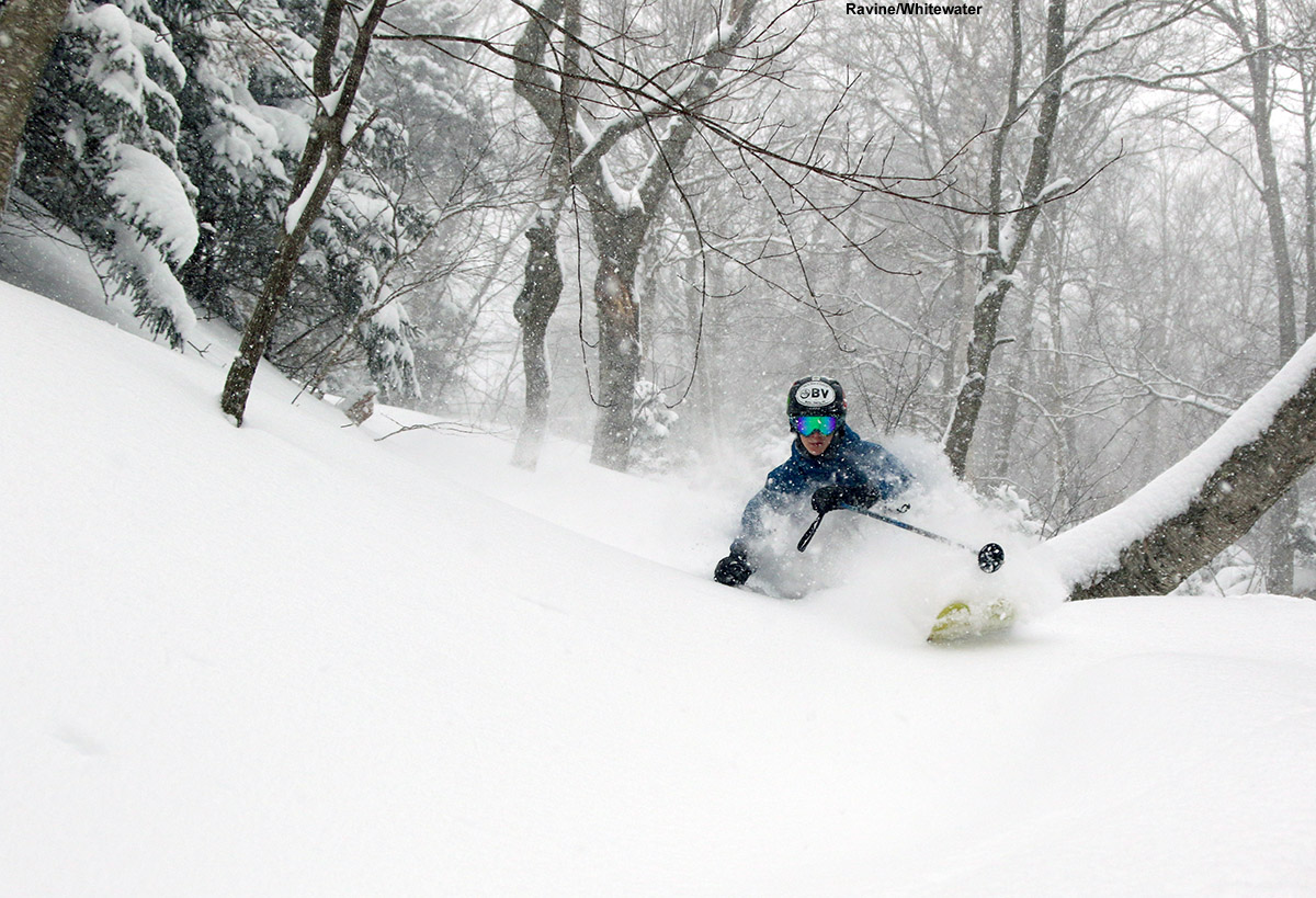 An image of Ty skiing deep powder in the Ravine/Whitewater area at Stowe Mountain Resort in Vermont during Winter Storm Stella