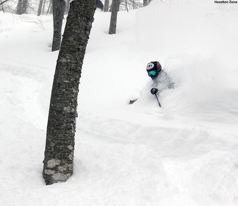 An image of Ty skiing deep powder in the Hazelton Zone at Stowe Mountain Resort in Vermont after Winter Storm Stella