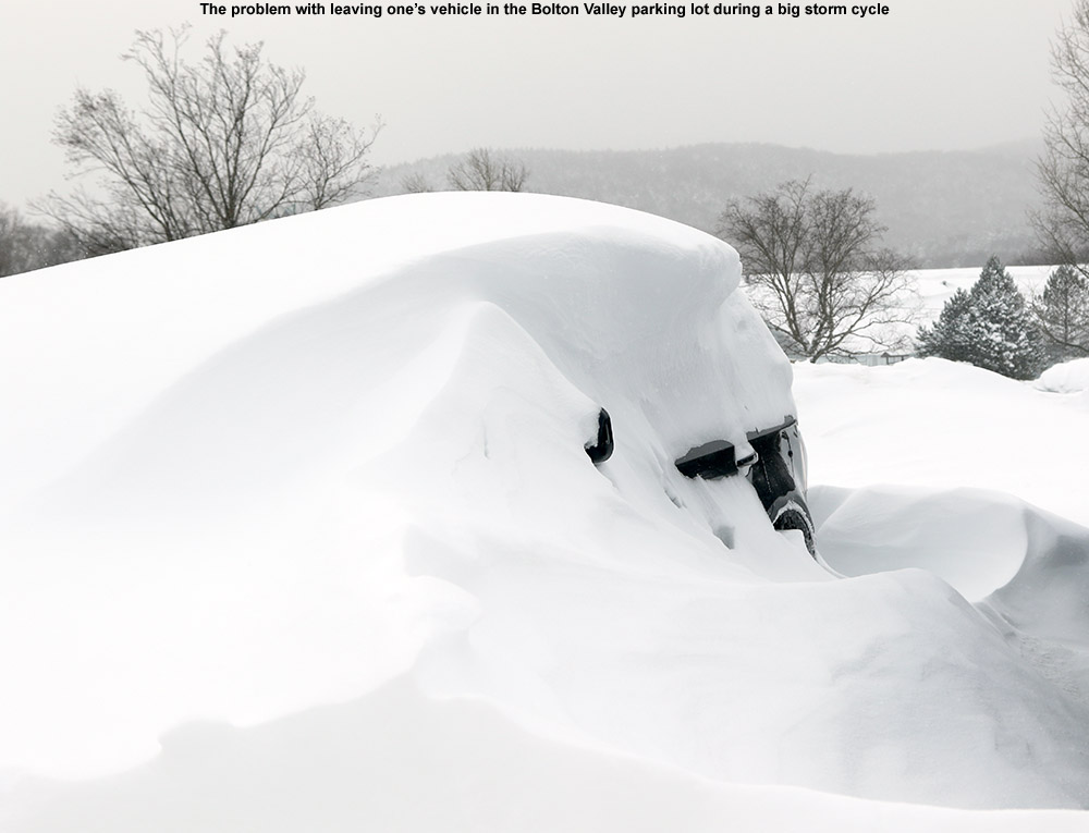 An image of a car, barely visible under drifted snow at Bolton Valley Ski Resort in Vermont