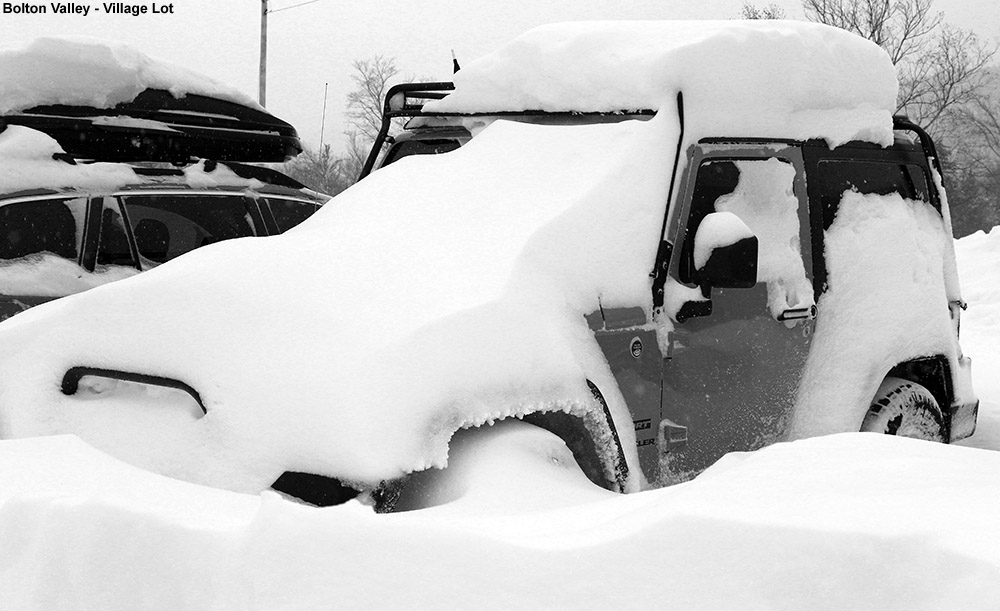 An image of a car with drifted snow at Bolton Valley Ski Resort in Vermont