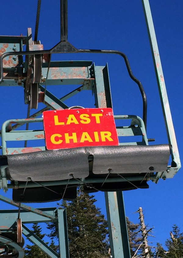 An image of the last chair sign on the Wilderness Double Chairlift at Bolton Valley Ski Resort in Vermont