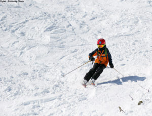 An image of Dylan skiing Profanity Chute above Stowe Mountain Resort in Vermont