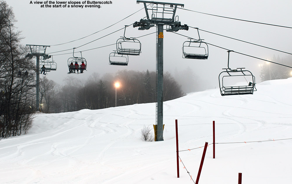 An image showing snowly slopes with fresh powder as night skiing gets going at Bolton Valley Ski Resort in Vermont