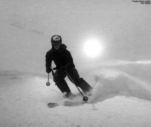 An image of Ty night skiing in a snowstorm at Bolton Valley Resort in Vermont
