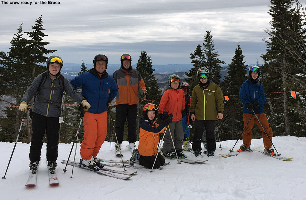 An image of BJAMS students and ski program coaches preparing for a trip down the Bruce Trail in the sidecountry of Stowe Mountain Ski Resort in Vermont