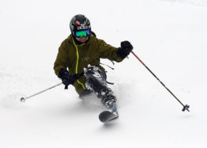 An image of Jay Telemark skiing in powder snow at Bolton Valley Resort in Vermont