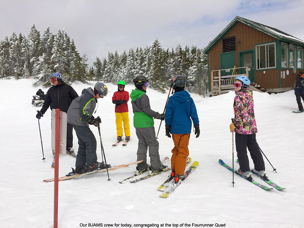 An image of BJAMS students at the top of the Fourrunner Quad at Stowe Mountain Resort in Vermont