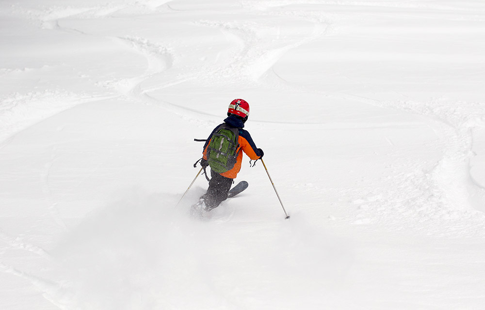 An image o Dylan Telemark skiing in powder at Bolton Valley Resort in Vermont