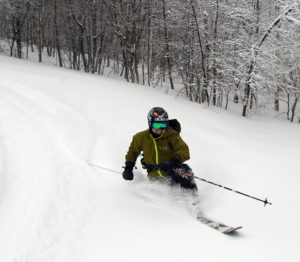 An image of Jay Telemark skiing in powder at Bolton Valley Resort in Vermont