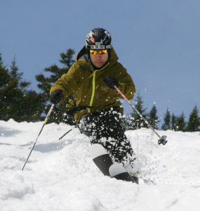 An image of Jay skiing moguls on the Centerline trail at Stowe Mountain Resort in Vermont