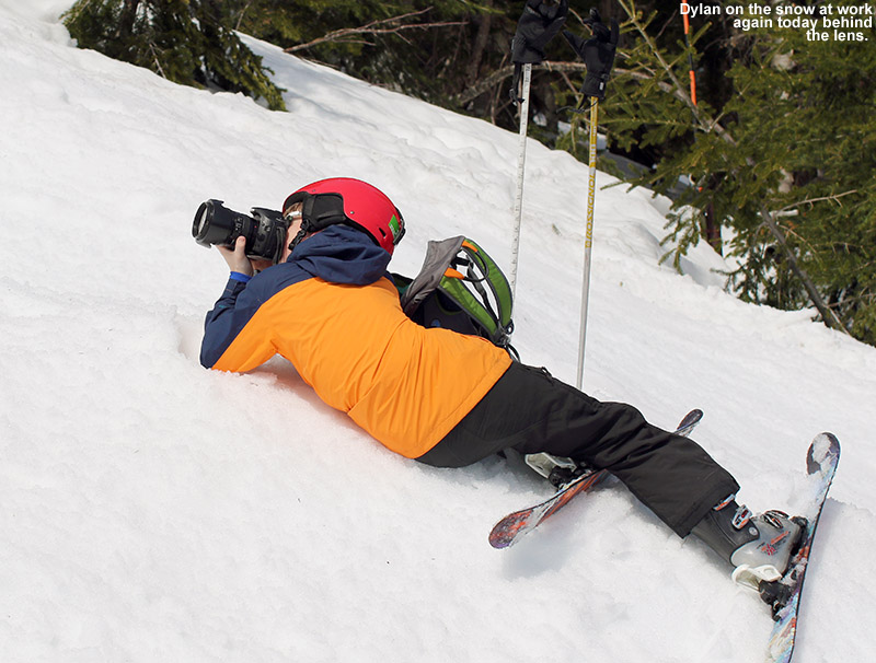 An image of Dylan on the snow doing some ski photography at Stowe Mountain Resort in Vermont