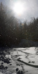An image of ski tracks in powder snow and snowflakes in the air at Bolton Valley Resort in Vermont